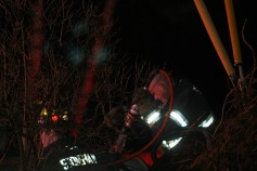 Firefighters use the Jaws of Life to cut the roof free